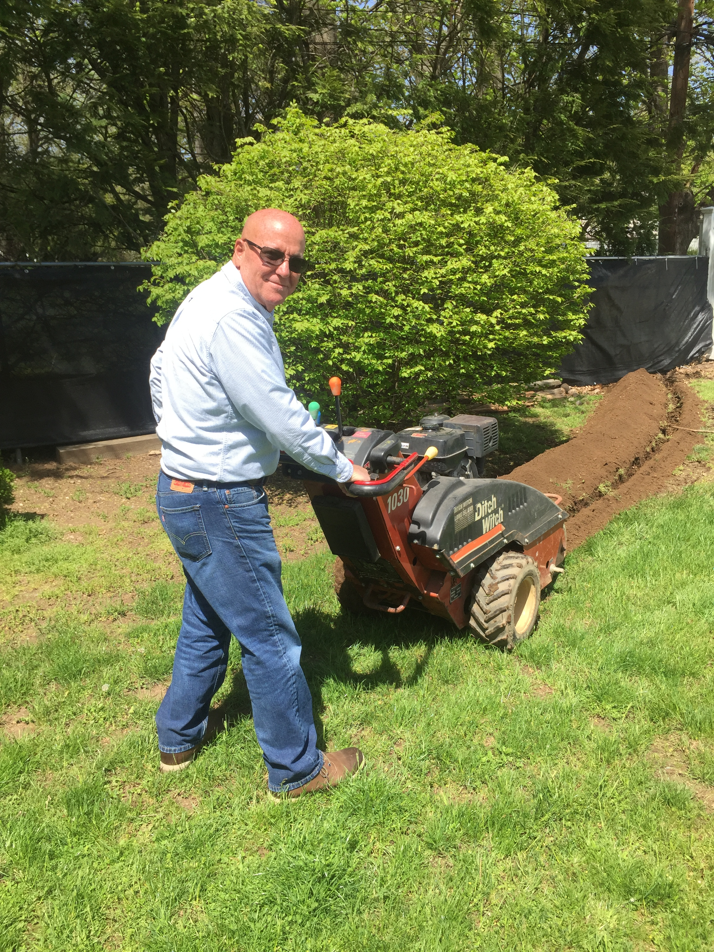 Peter Lombardo trenching electrical ditch witch service underground service deer park long island electricians